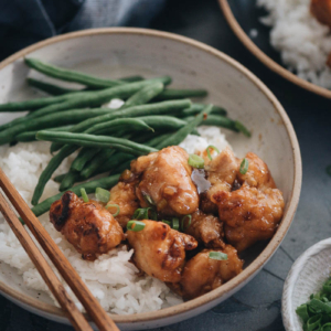 Homemade crispy Chinese honey chicken served in bowls close up