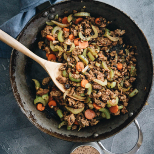 Ground beef stir fry with celery in a frying pan