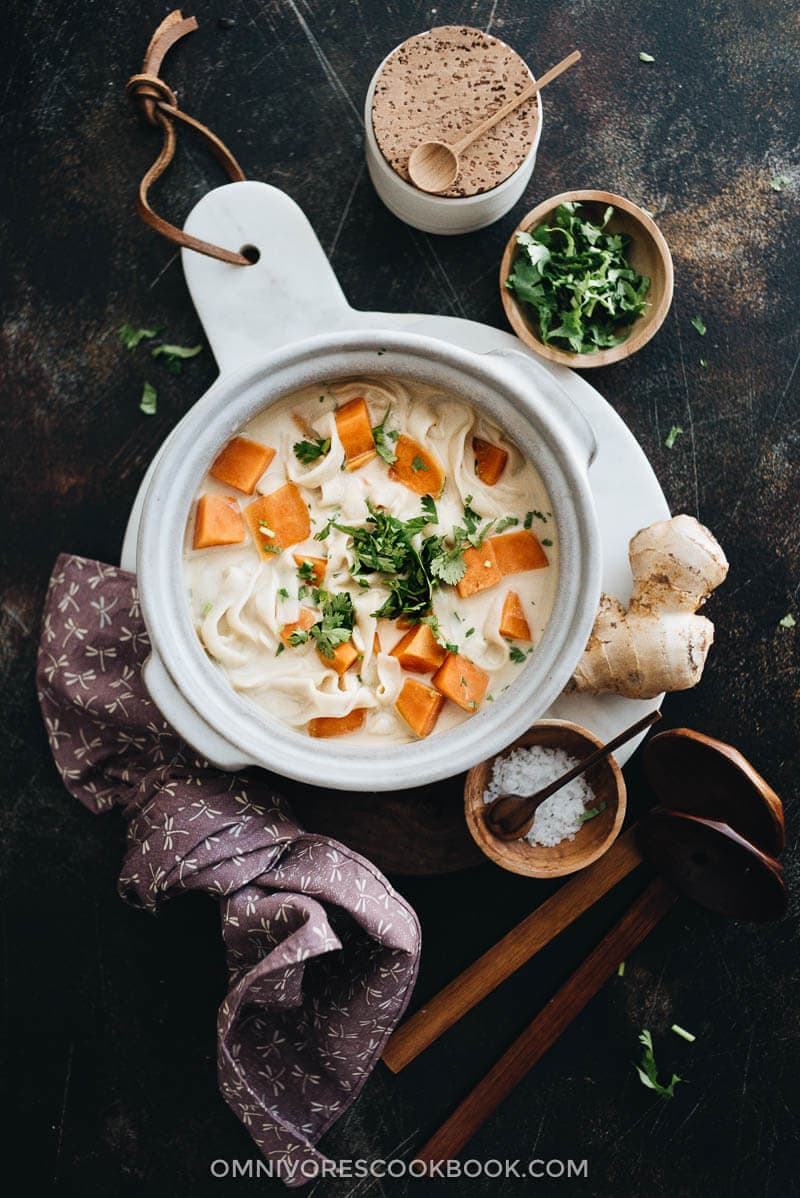 5-Ingredient coconut noodle soup served on marble board