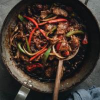 Szechuan beef stir fry in a pan