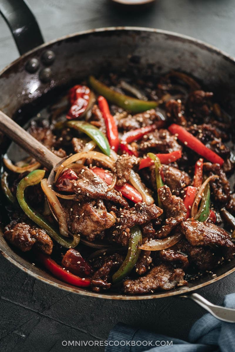 Szechuan beef stir fry served in a plate with rice