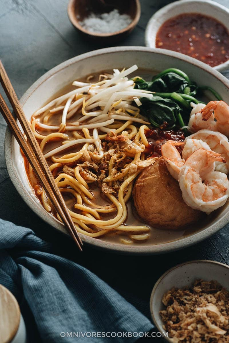 Hokkien Prawn Mee Noodle Soup (Hae Mee) topped with shrimp, fish cake, bean sprouts, and spinach