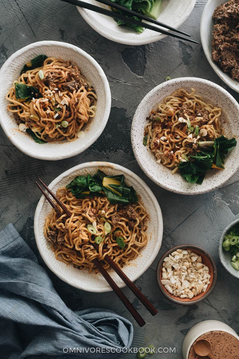 Vegan dan dan noodles served in small bowls