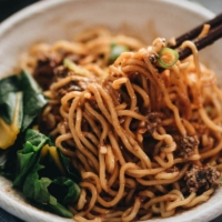 """Vegan Dan Dan noodles - The tender noodles are served with a rich sauce that is nutty, spicy, and extra fragrant, with a hint of sweetness. It also comes with a vegan recipe for a flavorful """"meat"""" topping that tastes great and clings to the noodles, just like real meat. Be careful, this dish is addictively tasty! {Gluten Free adaptable} #chinese #recipes"""