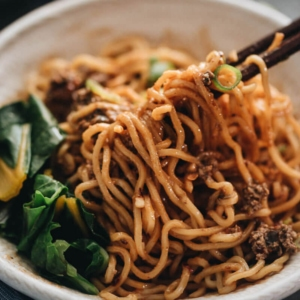 "Vegan Dan Dan noodles - The tender noodles are served with a rich sauce that is nutty, spicy, and extra fragrant, with a hint of sweetness. It also comes with a vegan recipe for a flavorful ""meat"" topping that tastes great and clings to the noodles, just like real meat. Be careful, this dish is addictively tasty! {Gluten Free adaptable} #chinese #recipes"