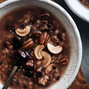 Eight Treasure Congee - Made with whole grains, nuts, and dried fruits, it's nutritious, comforting, and easy to make. It's a perfect side for a weekday dinner and it tastes as good as a dessert. Both stovetop and Instant Pot versions are included. #glutenfree #vegan