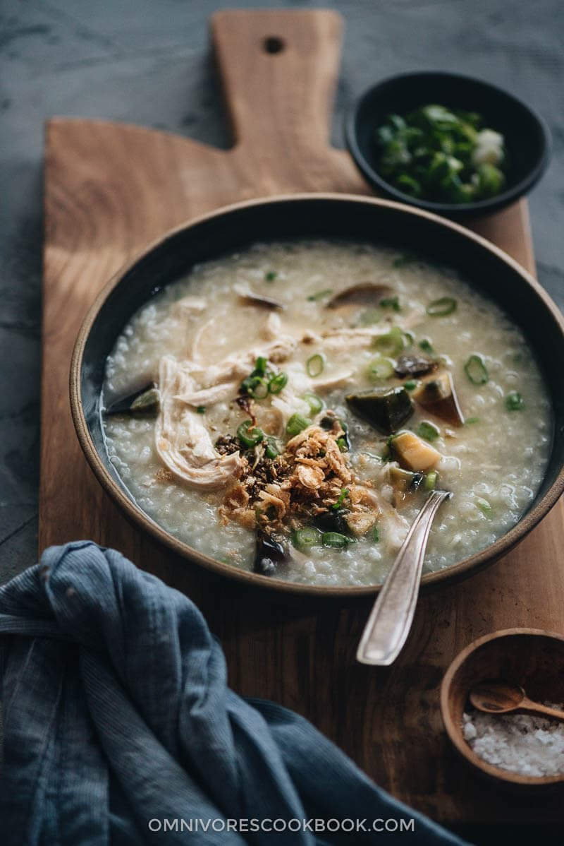 Homemade century egg congee with chicken topped with fried shallot