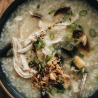 Century Egg Congee with Chicken - Silky creamy congee with shredded chicken cooked in one pot. This recipe requires minimal prep and includes both an Instant Pot version and a stovetop version. {Gluten-Free adaptable} #chinese #comfortfood