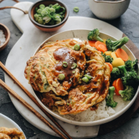 Egg foo young with gravy on rice