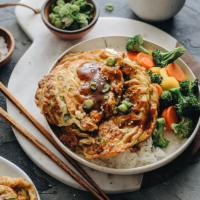 Easy Egg Foo Young - Crispy fluffy egg foo young filled with crisp veggies and aromatic green onion and served with a rich brown sauce. It's super easy to make and tastes so satisfying. Serve it with steamed rice and veggies and you'll have a nutritious meal in no time.