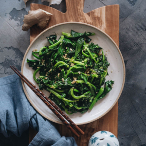 Homemade stir-fried pea shoots with garlic