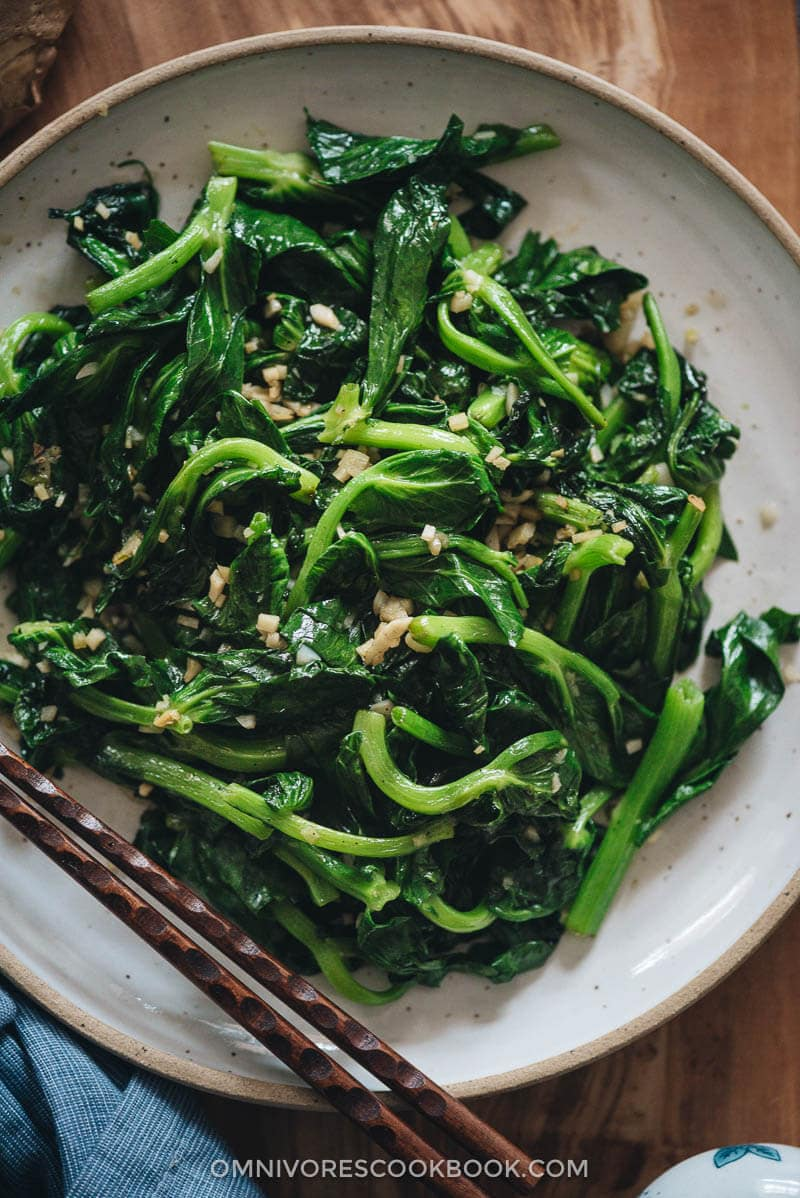 Homemade stir-fried pea shoots with garlic close up