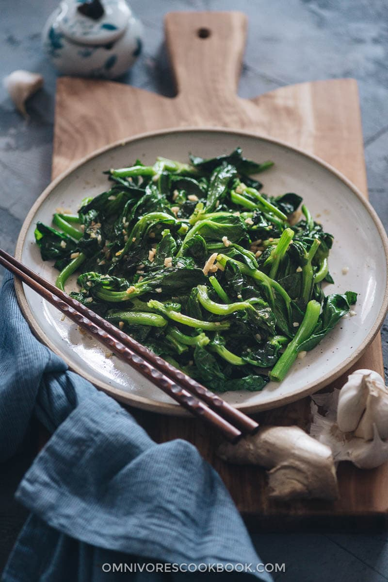 Homemade stir-fried snow pea shoots with garlic