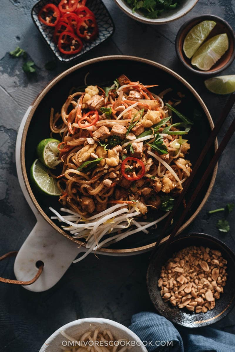 Vegan Pad Thai garnished with bean sprouts and lime