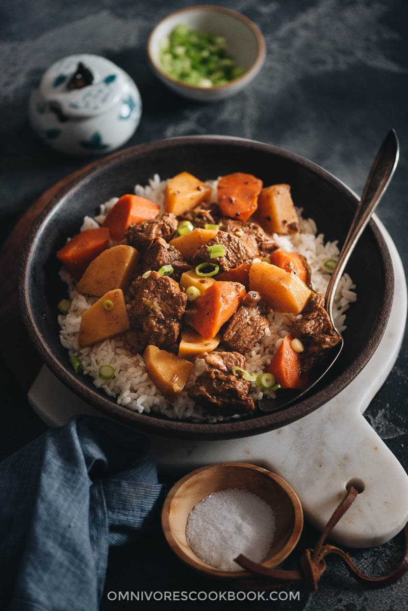 Chinese beef stew with potato and carrot served on rice