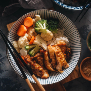 Chinese Yoshinoya style teriyaki chicken served on rice with veggies