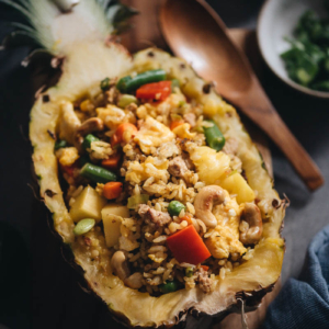 Easy pineapple fried rice served in pineapple bowl