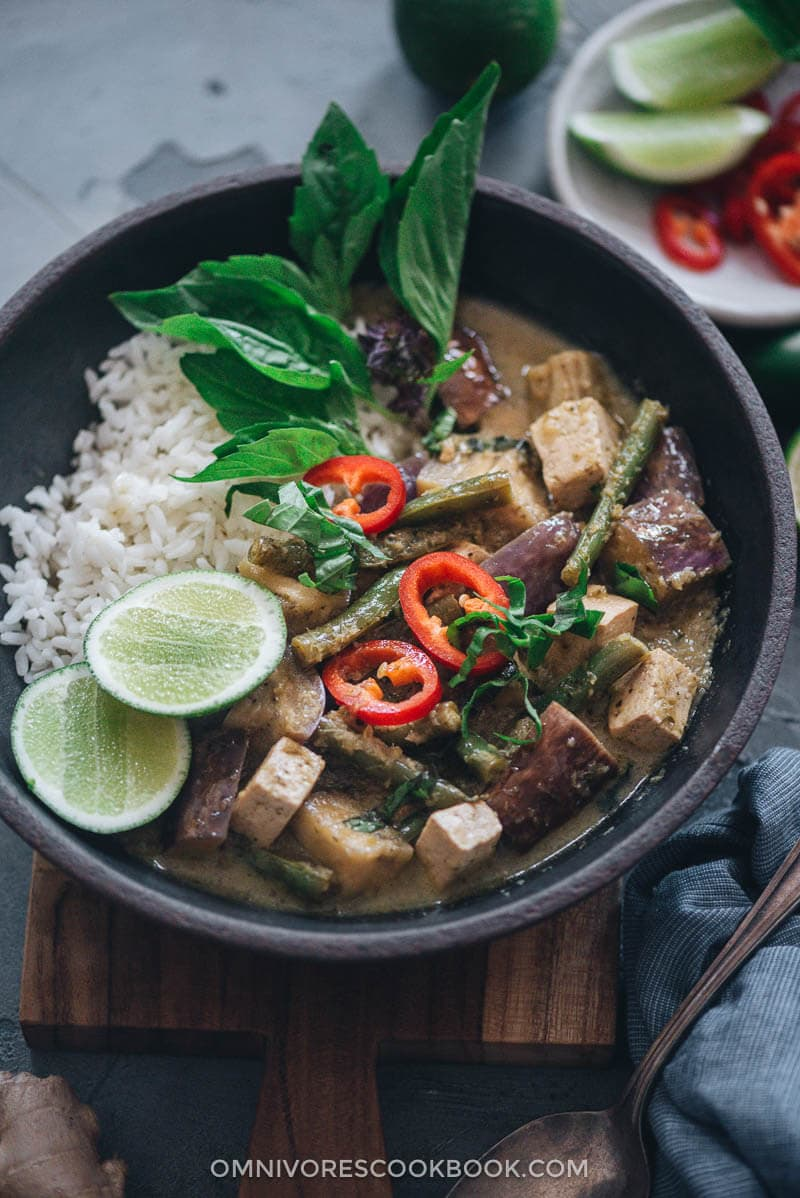 Vegan Thai green curry served with rice and lime wedges