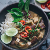 Vegan Thai Green Curry - A scrumptious, rich and creamy vegan Thai green curry made easy with fresh aromatics and colorful veggies. Top it on steamed rice and you'll have a healthy, nutritious one-bowl meal that's bursting with flavor. {Vegan, Gluten-Free}