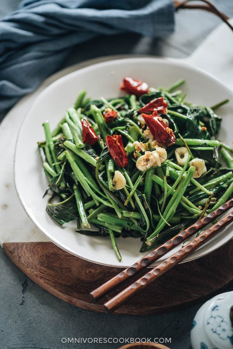 Stir fried water spinach served on a plate