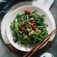 Stir-Fried Water Spinach - Two Ways | Introducing two ways to cook stir-fried water spinach, and both require fewer than five ingredients. Try out this Chinese leafy green to add color and nutrition to your dinner table. {Vegan, Gluten-Free}