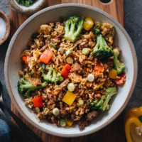 Easy Beef Fried Rice - This easy beef fried rice uses a bold seasoning of chili and cumin. It requires very little prep and only takes 10 minutes to cook. A one-pan dish that's satisfying enough to serve as a main for dinner, or packed into your lunch box for meal-prep, or can be served as a fancy side for your Chinese dinner party. {Gluten-Free adaptable}