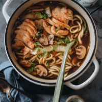 Chicken udon soup in a pot