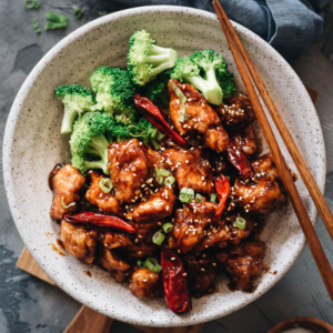 General Tso's Chicken - An easy General Tso's chicken recipe that yields crispy chicken without deep-frying, served with a sticky, tangy, and sweet sauce. It also uses much less sugar while maintaining a great bold taste. Once you've tried it, you'll skip takeout next time because it's so easy to make in your own kitchen. {Gluten-Free Adaptable}