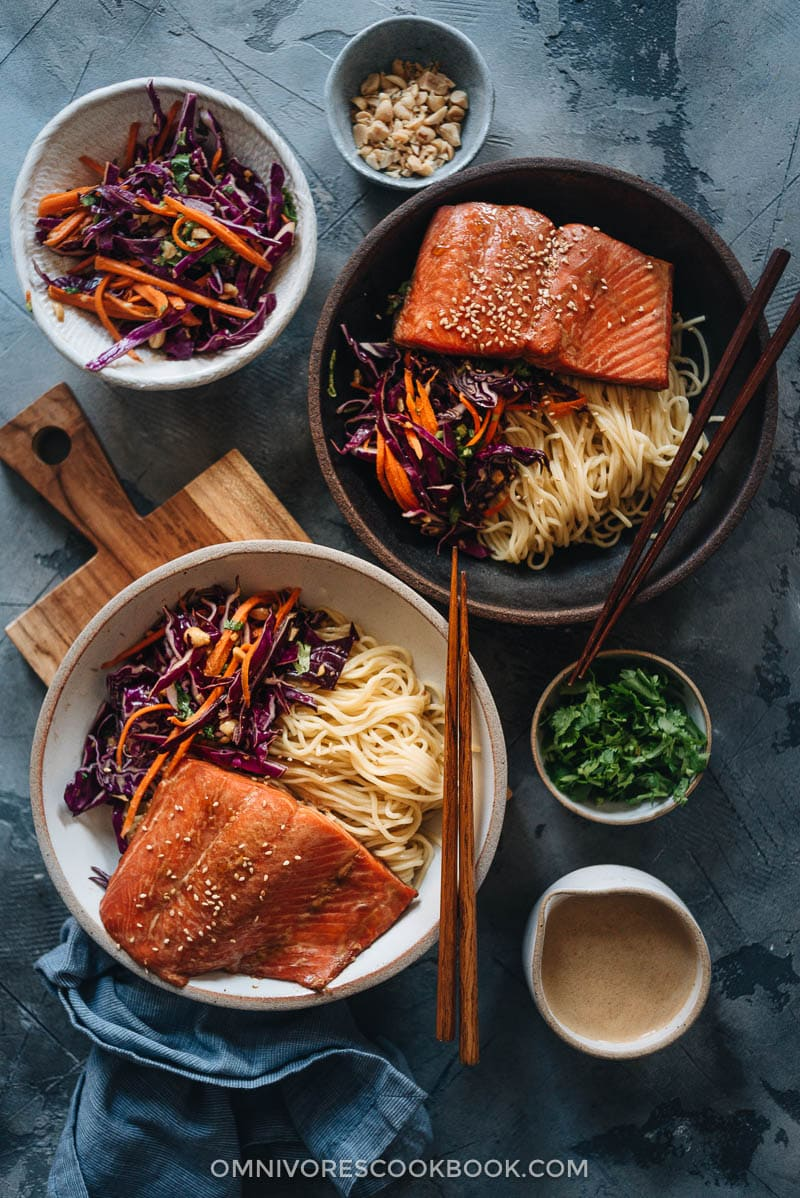 Salmon noodle bowl with coleslaw and sauce on the side