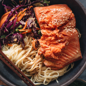 Noodles with flaky salmon on top