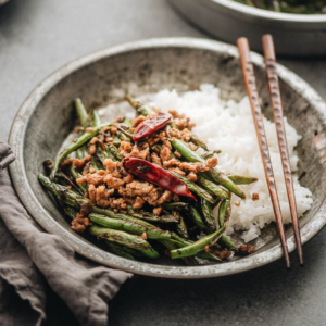 Sichuan Dry Fried Green Beans (干煸四季豆) - Blistered and charred green beans are tossed with an aromatic sauce, making this dish too good to pass up, and it's substantial enough to serve as a main. {Vegan Adaptable, Gluten Free Adaptable}