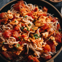 15-Minute Tomato Egg Noodles | Make this dish when you're in a rush because it takes no time to whip it up for a comforting meal. The scrambled eggs are cooked with tomatoes, aromatics, and a drizzle of soy sauce to create a simple scrumptious sauce, served on top of boiled noodles. So simple and hearty. {Gluten-Free adaptable}