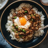 Cantonese Mince Beef Rice and Eggs | A super easy Cantonese minced beef bowl cooked with an oyster-sauce-based sauce, onion, green peas, and runny eggs. Top it on steamed rice or noodles to make a hearty and healthy meal. It's also perfect to make ahead and use as meal-prep. {Gluten-Free Adaptable}
