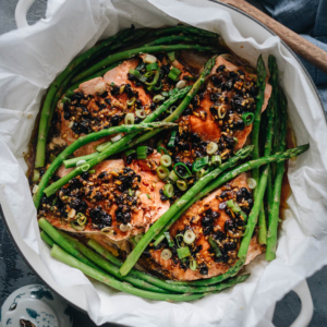 Steamed Salmon in Black Bean Sauce - The steamed salmon is cooked until tender and moist and the asparagus perfectly done. The dark black bean sauce complements both ingredients perfectly and turns these simple ingredients into a feast. The dish takes no time to set up and cook. And you'll get a nutritious and delicious one-pan dinner in 30 minutes. {Gluten-Free adaptable}