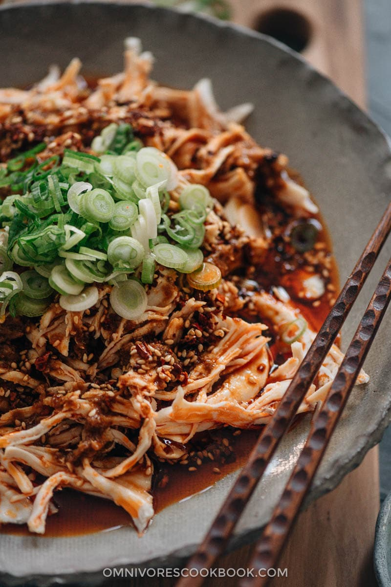Sichuan-style shredded chicken in red oil close-up