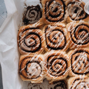 Cinnamon rolls in a pan with glaze
