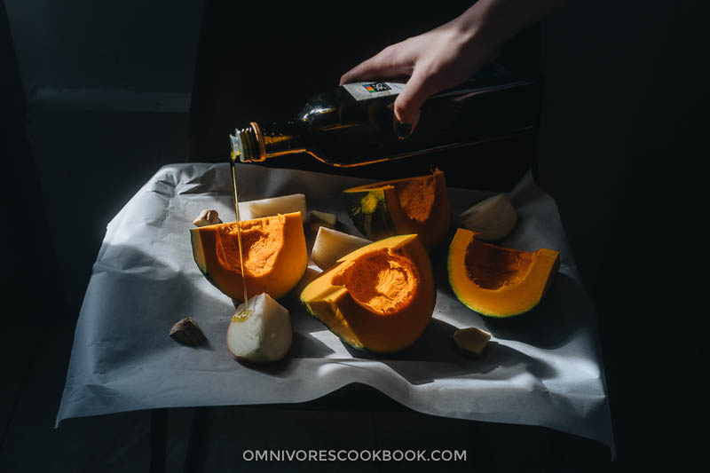 Drizzle olive oil on kabocha squash
