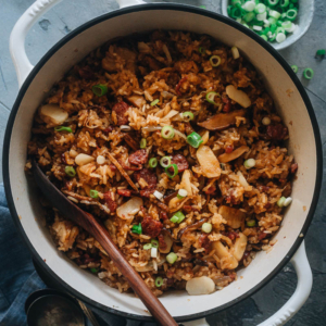 Sticky Rice Stuffing (A Chinese-Inspired Thanksgiving Recipe) | This rich, savory, and buttery sticky rice stuffing is made with sweet Chinese sausage, smoky mushrooms, and crunchy water chestnuts. Cooked with butter, fresh aromatics, and finished up with a drizzle of soy sauce, this hearty stuffing will go well with your regular Thanksgiving dishes while spicing up your dinner party with an exotic touch. {Gluten-Free adaptable}