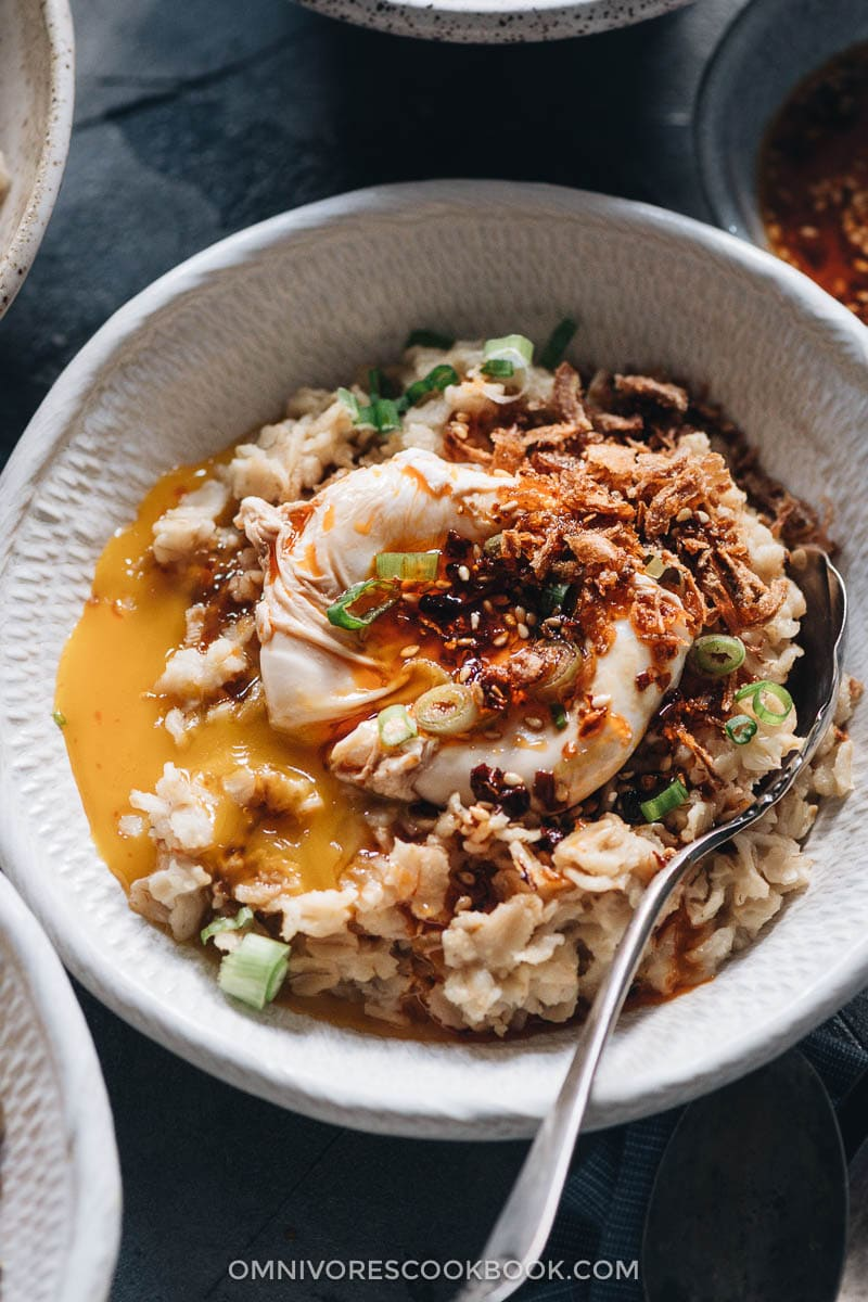 Savory oatmeal topped with egg close-up