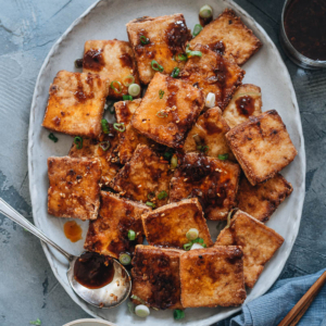 Crispy Marinated Tofu | This recipe generates the most flavorful marinated tofu! The tofu pieces are soaked in a savory spicy Asian sauce, then pan fried until crispy. It's very easy to put together and yields crispy tofu bites that are bursting with flavor! {Vegan, Gluten-Free adaptable}