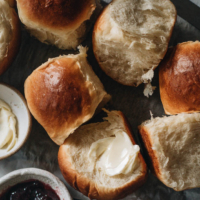 Easy Milk Bread Rolls | Make Hokkaido style milk bread rolls with this simple recipe. These milk bread rolls are super soft, airy, moist, and slightly sweet. They're very easy to put together and hold up well when made ahead. They're perfect for your holiday dinner party and simple enough to make as an everyday recipe.