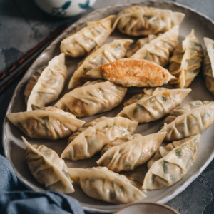 Turkey dumplings (A Thanksgiving Leftover Recipe) | Turn Thanksgiving leftovers into fancy dim sum using this turkey dumpling recipe. It uses leftover mashed potatoes, turkey, and cranberry sauce to make crispy, hearty, and juicy dumplings that are even better than takeout.