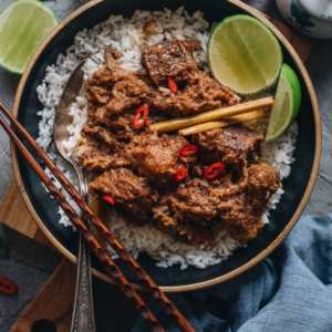 Beef rendang served on rice