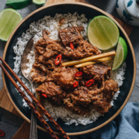 Beef Rendang | This dish features buttery, juicy beef smothered in a thick, rich, caramelized aromatic curry sauce. Learn how to make authentic Indonesian beef rendang in your own kitchen with an easy approach. You can also use a slow cooker to make this recipe. {Gluten-Free}