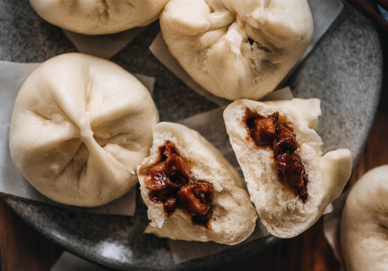 Char Siu Bao (Steamed BBQ Pork Buns) | Learn how to make authentic Chinese char siu bao just like a dim sum restaurant. The buns have very soft, fine, and fluffy bread with a juicy tender pork filling. My recipe includes detailed step-by-step photos and a video to help you achieve the best result in your own kitchen.