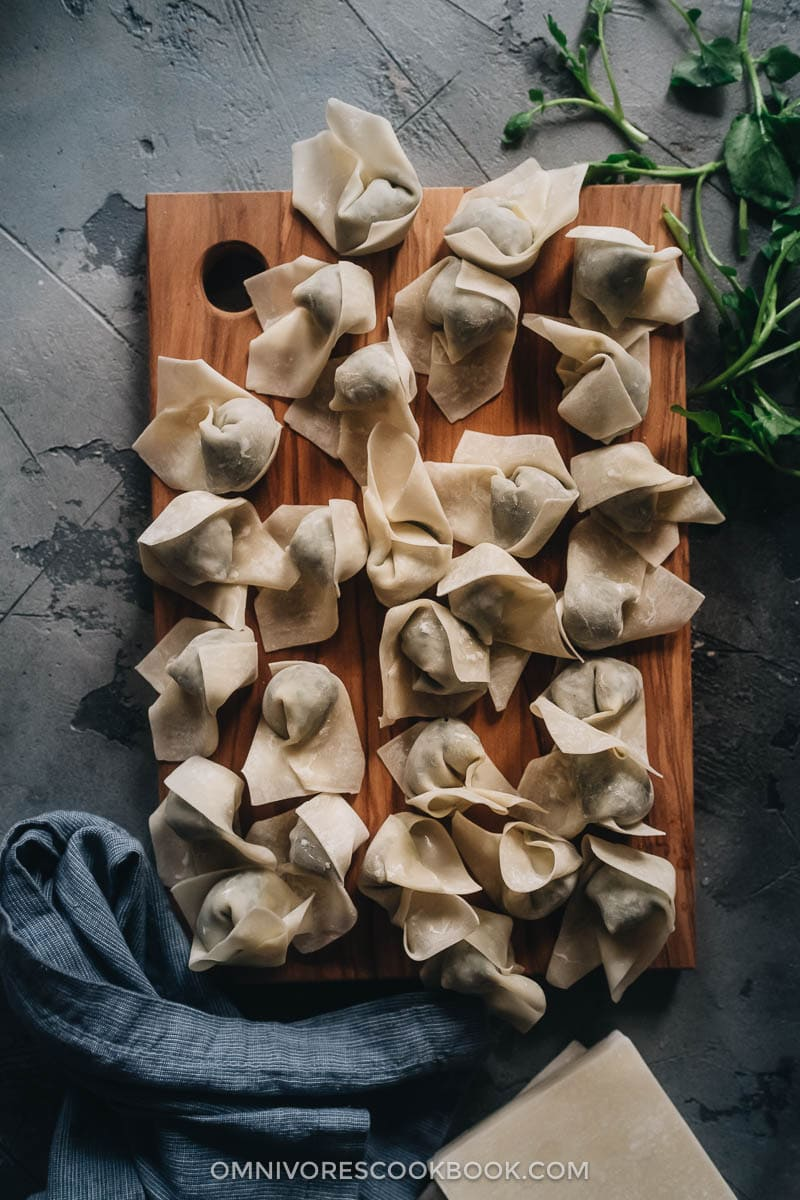 Uncooked wontons on a cutting board