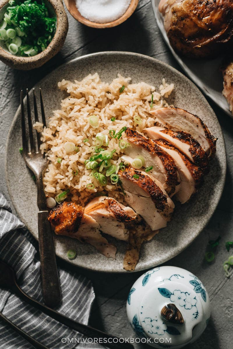 Sliced roast chicken breast served on rice