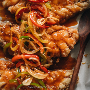 Chinese Sweet and Sour Fish (糖醋鱼) | This recipe uses fish fillets to create a stunning presentation while keeping the cooking process as easy as possible. The fish is shallow-fried until super crispy and then drizzled with a rich and aromatic sauce that is loaded with colorful peppers. It's a perfect dish to serve at your dinner party, for Chinese New Year, or for other Chinese festivals. {Gluten-Free Adaptable}