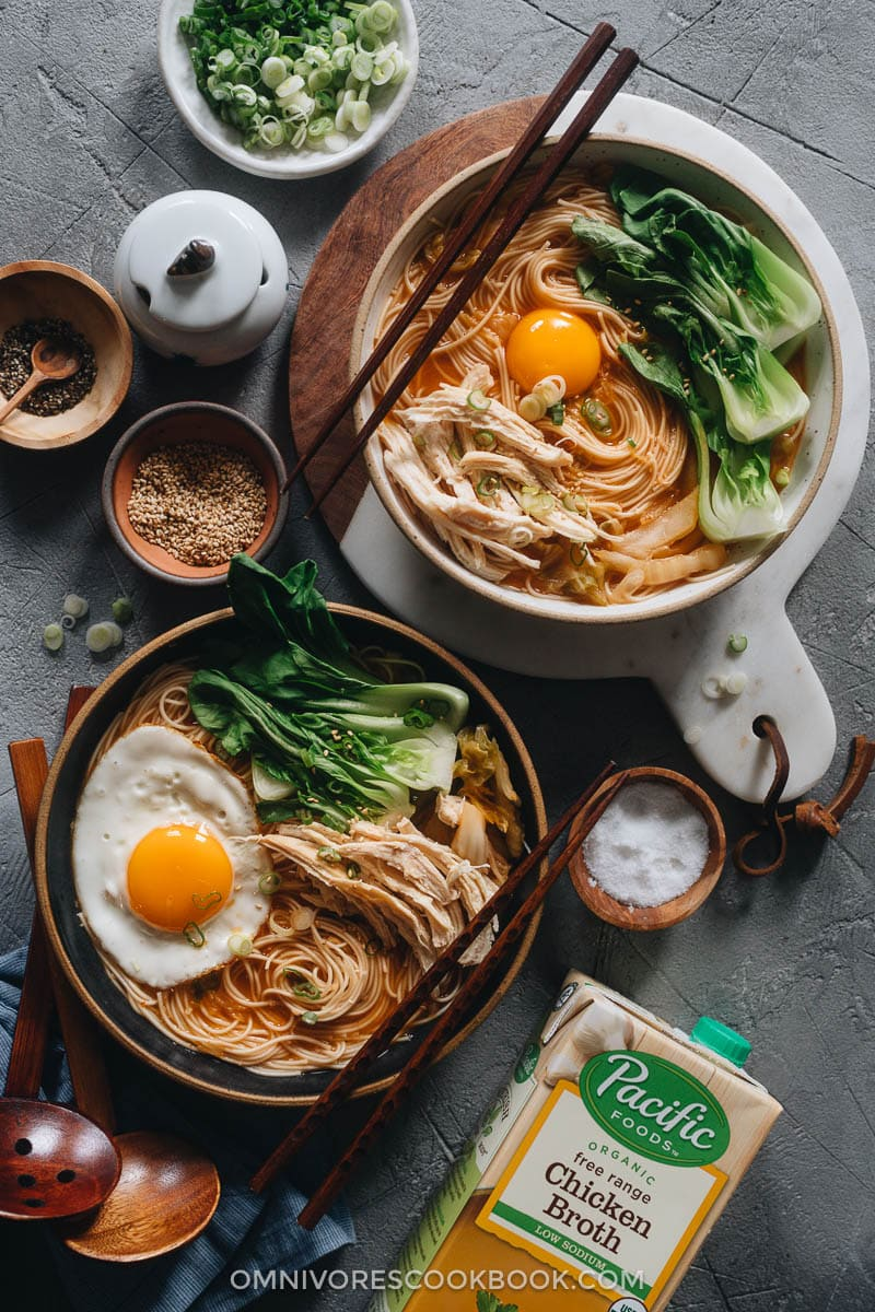 Korean noodle soup topped with egg and baby bok choy