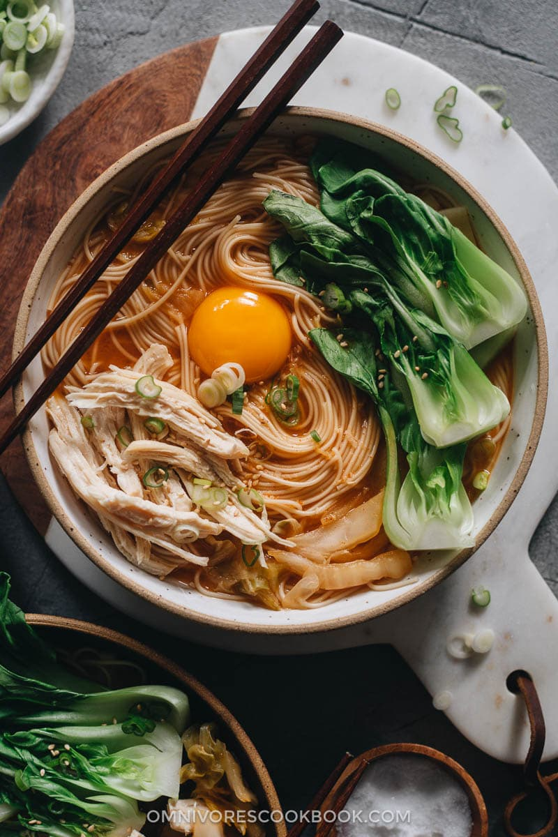 Korean noodle soup with chicken, egg and baby bok choy